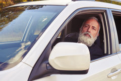 Middle-aged-man-sitting-white-car-handsome-looking-distance-61136130