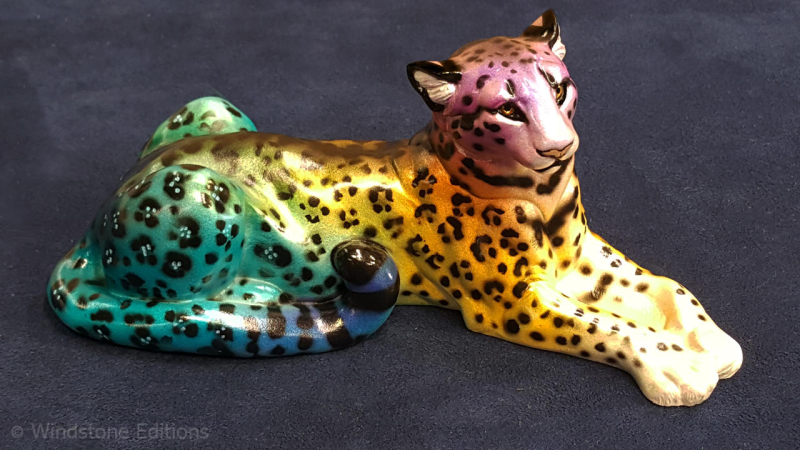 Rainbow_leopard_cougar_by_reptangle_ddao2aa-fullview